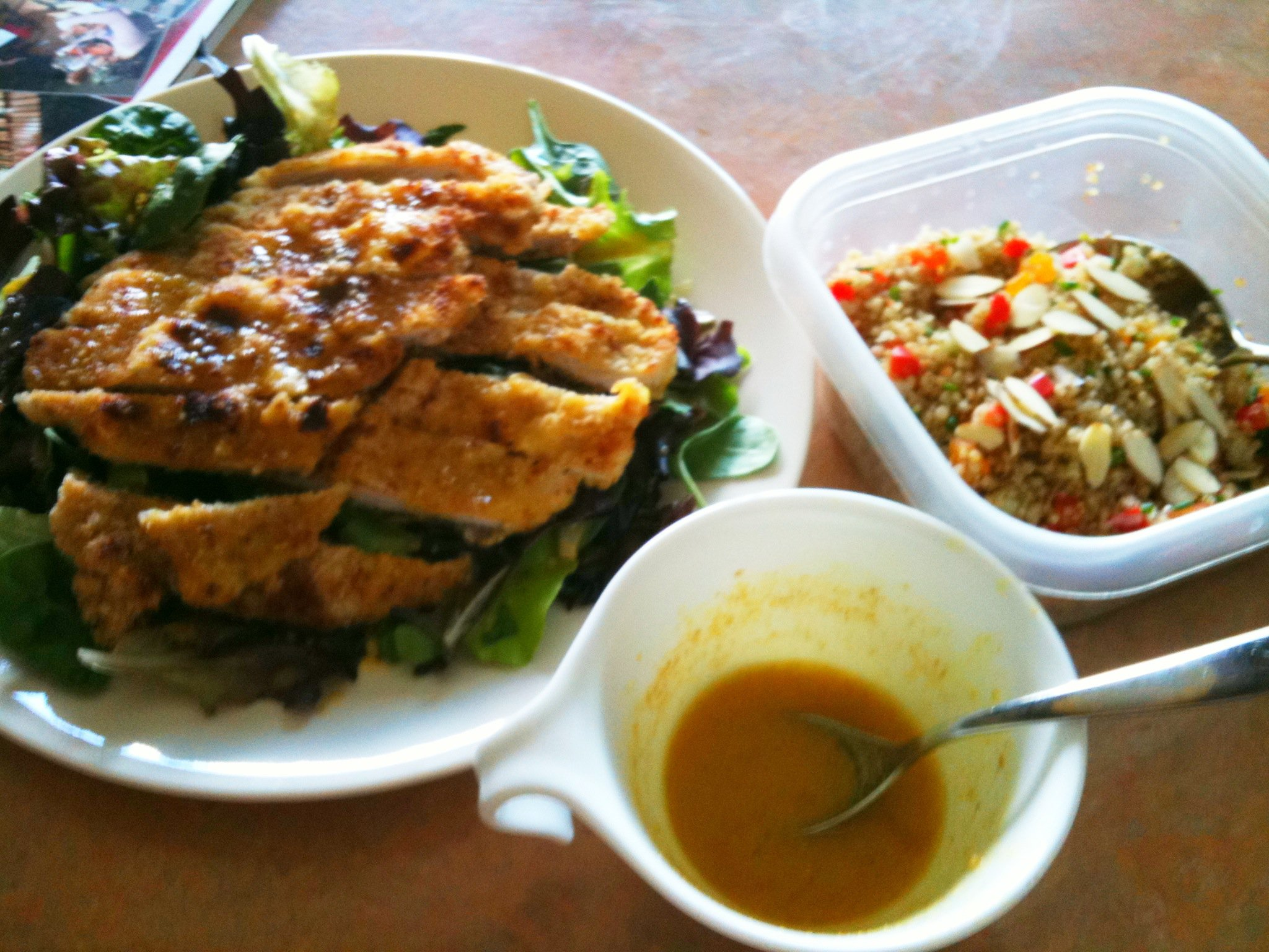 Breaded pork cutlet, quinoa salad and curry mustard orange dressing