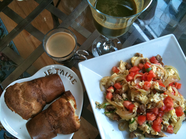 Sausage scramble, popover, green juice, and espresso
