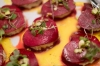 red beet ravioli with cashew cheese filling tarragon pistachios and yellow bell pepper sauce